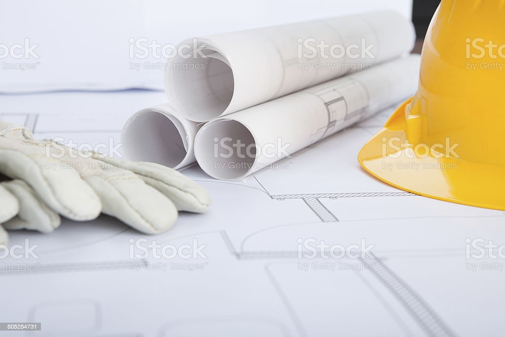 Close-up Of Blue Print And Hard Hat royalty-free stock photo