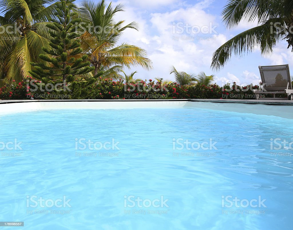 Closeup of blue swimming pool on sunny day royalty-free stock photo