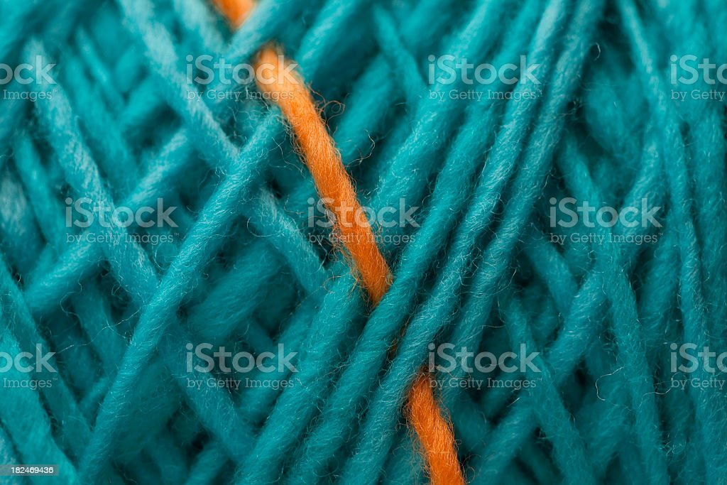Close-up of blue yarn with a single orange strand stock photo