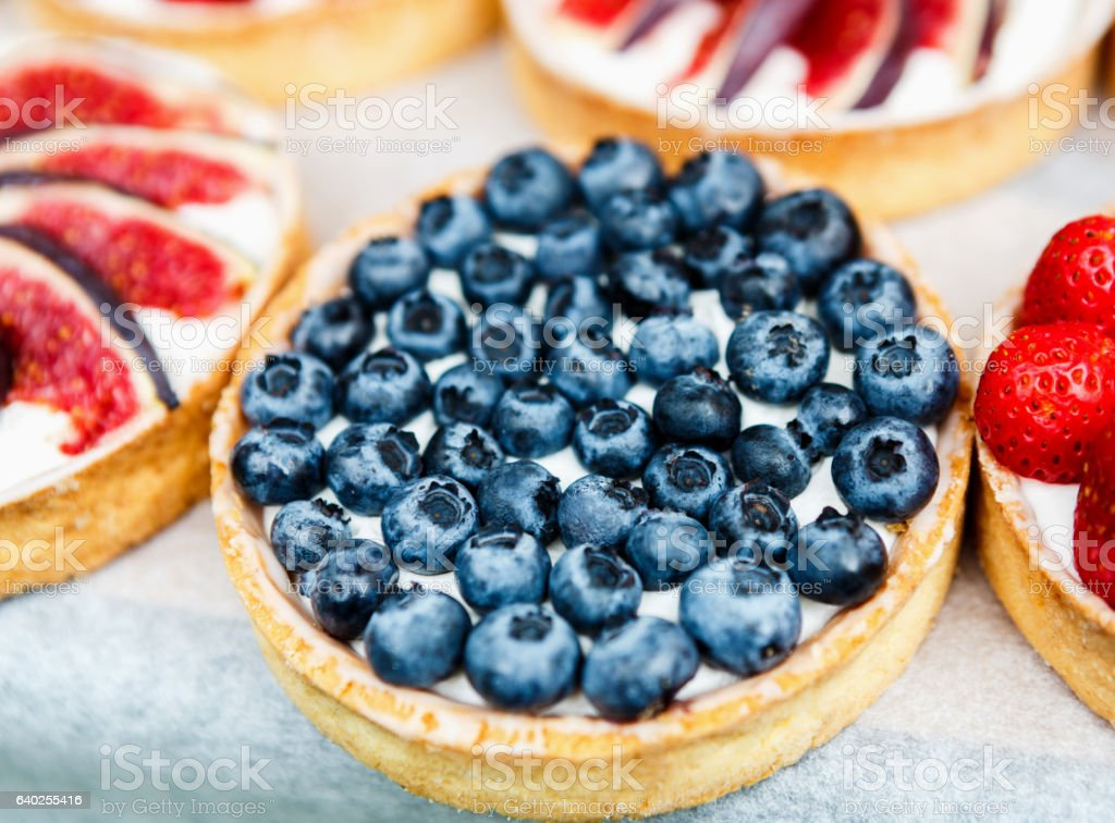 Closeup of blueberry tart dessert tray assorted stock photo