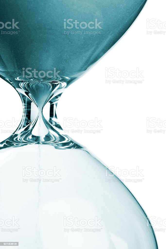 Close-up of blue-toned sand in an hourglass royalty-free stock photo