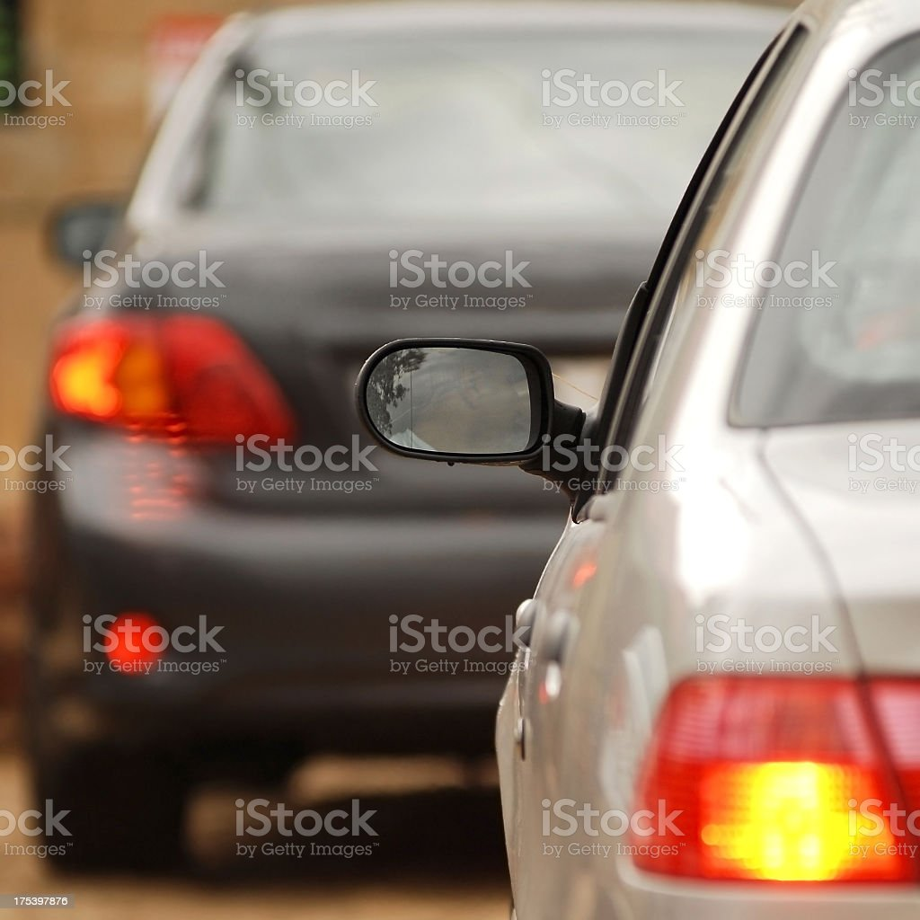 Close-up of blurred and on focus cars in traffic jam stock photo