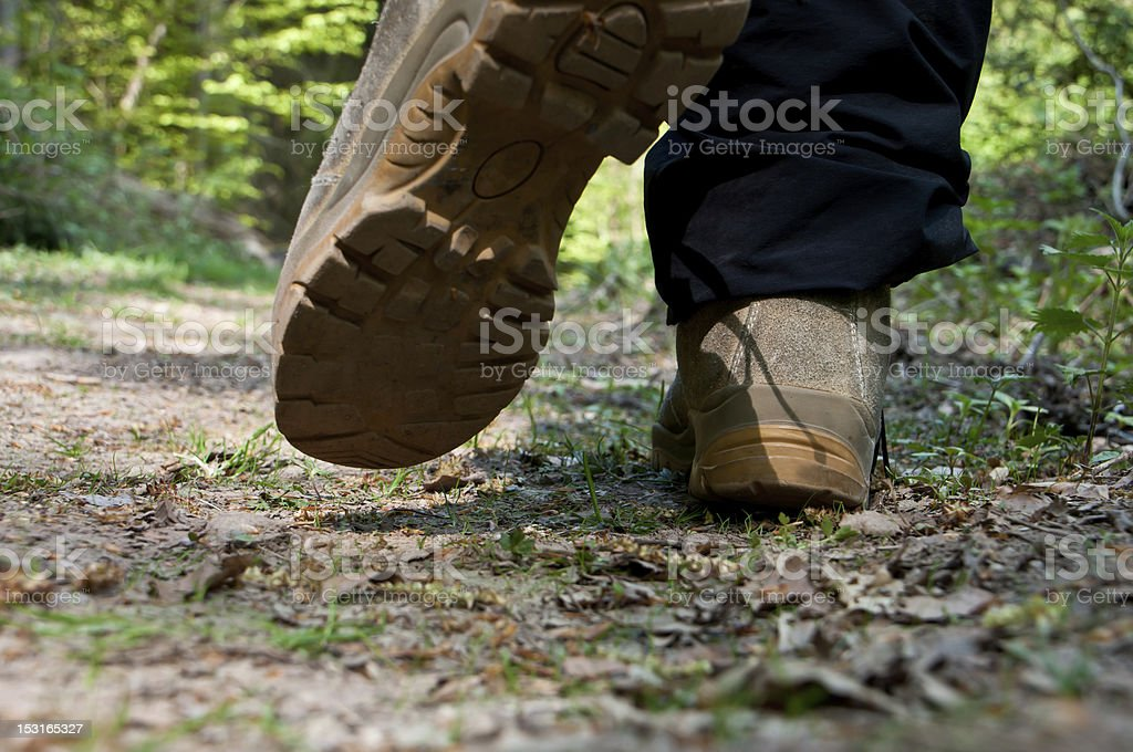 Closeup of boots while walking stock photo