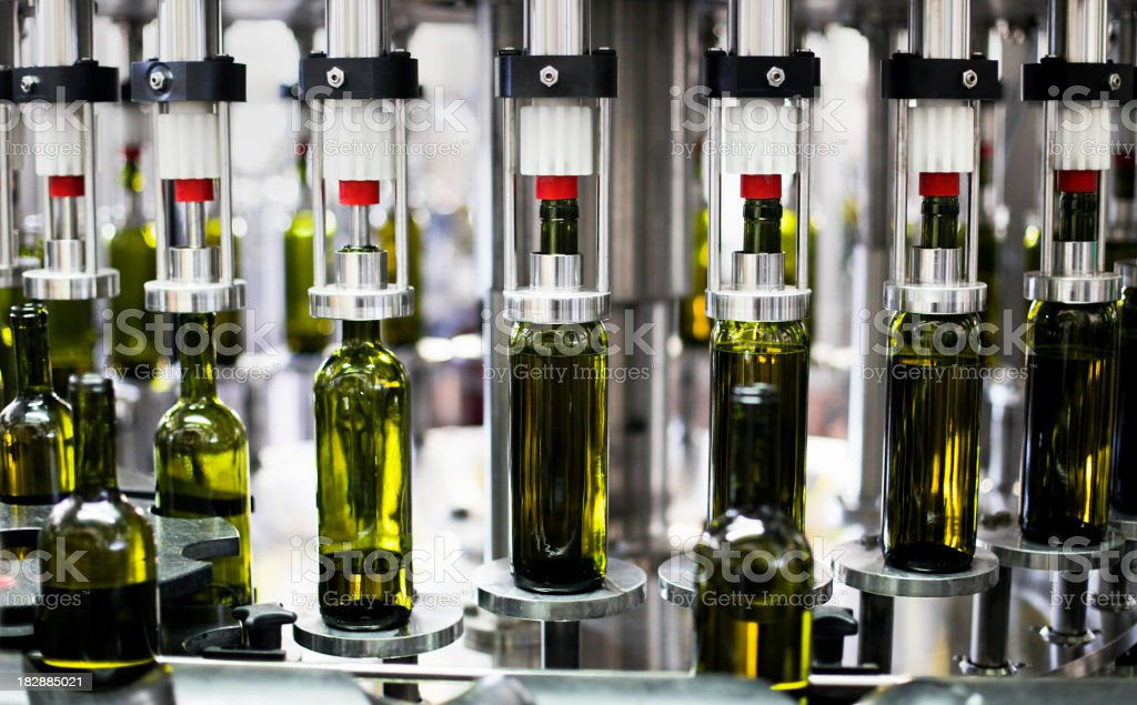 Close-up of bottles in a bottling plant factory stock photo