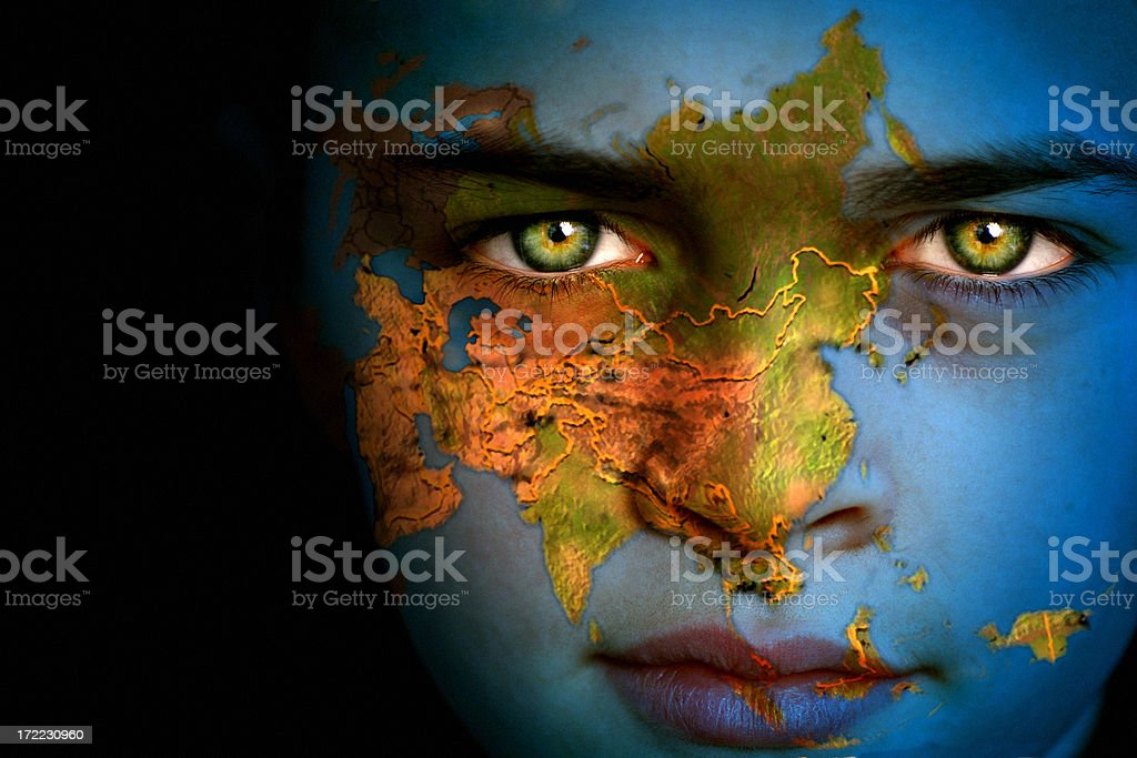 Close-up of boy with Earth map, Asia focus on face stock photo