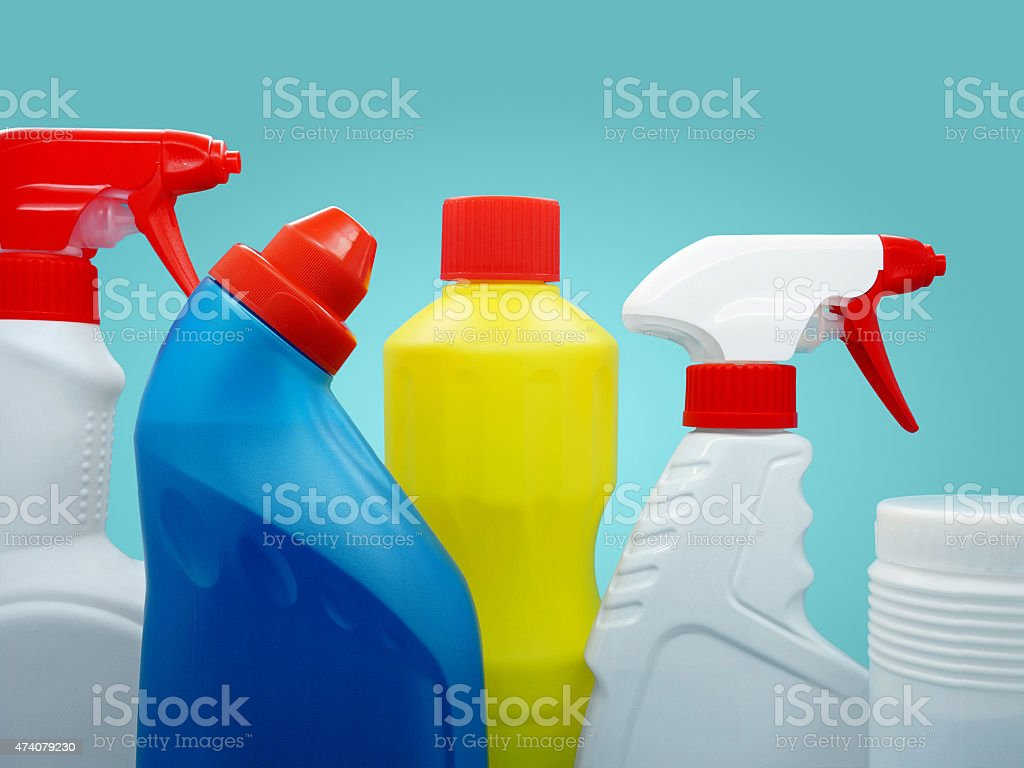 Closeup of brand-stripped cleaning products stock photo