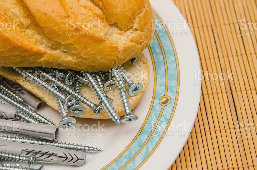 Close-up of bread with nails and dowels stock photo