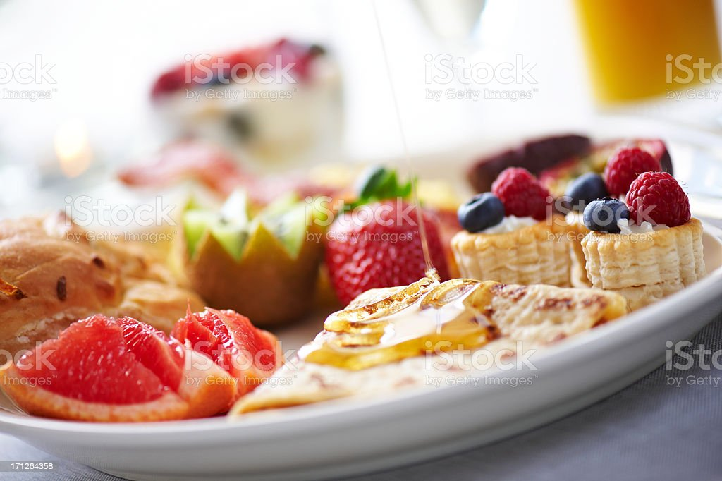 Close-up of breakfast with fruits and waffles royalty-free stock photo