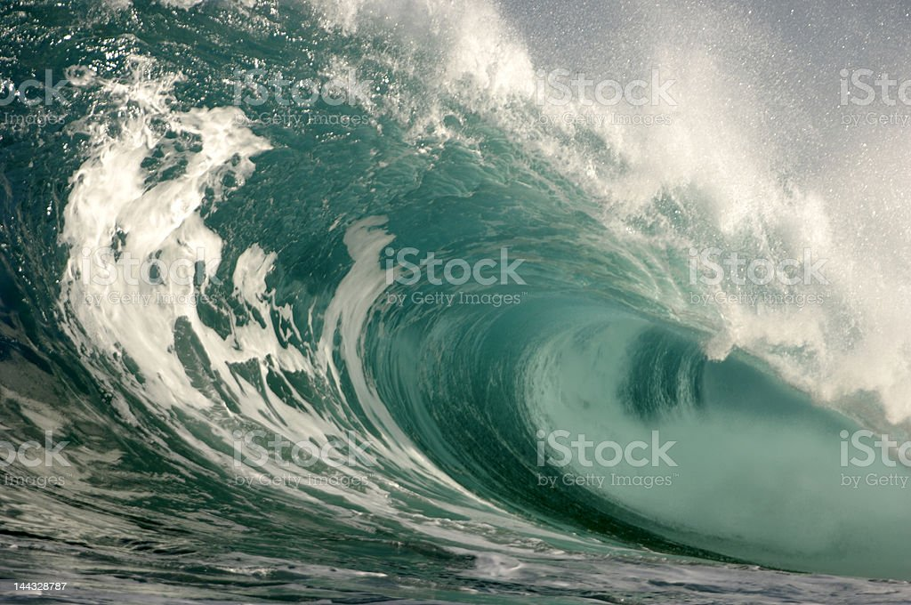 Close-up of breaking wave as it rolls onto itself stock photo