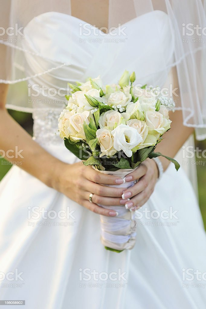 closeup of bride hands holding beautiful wedding bouquet royalty-free stock photo