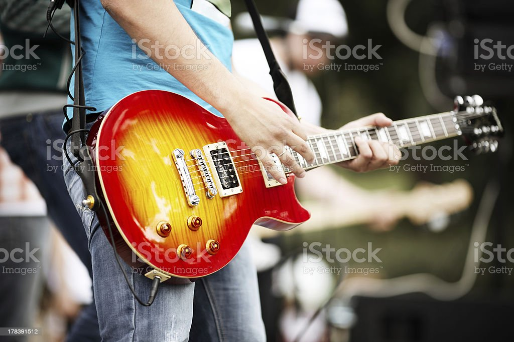 Close-up of bright electric guitar at Rock and roll concert stock photo