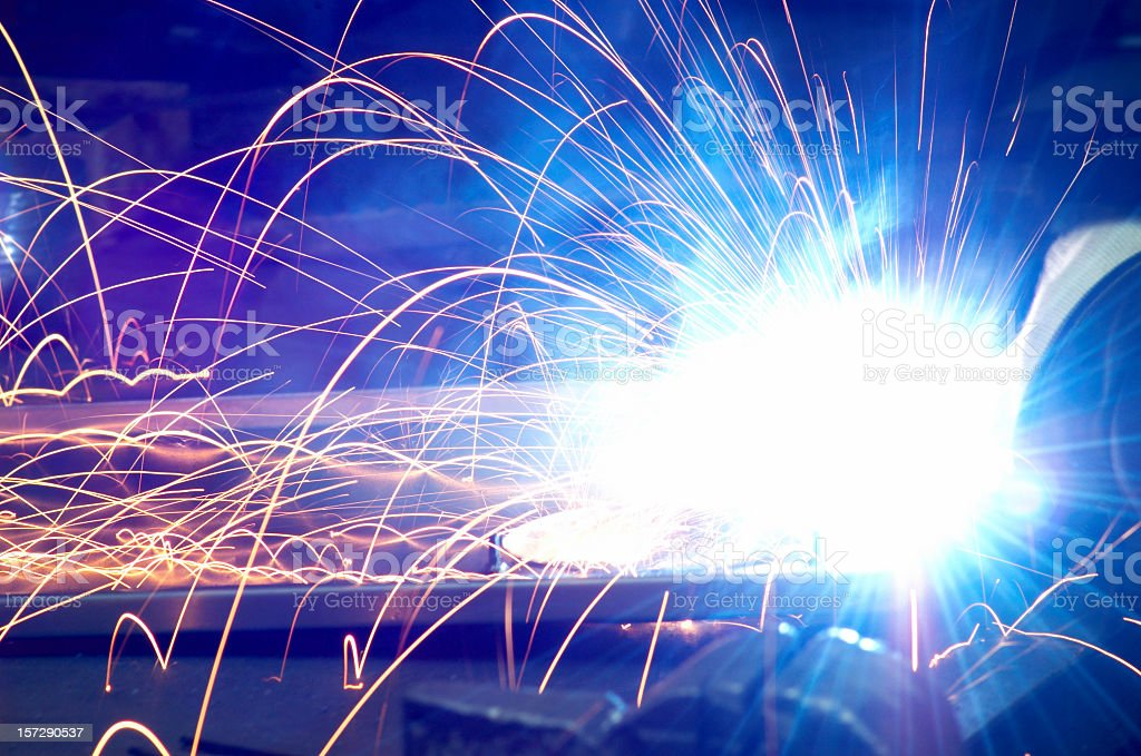 Close-up of bright light from welding with orange sparks royalty-free stock photo
