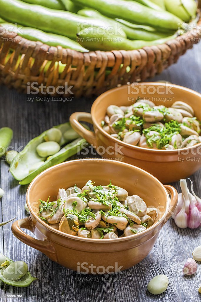 Closeup of broad beans served with parsley stock photo