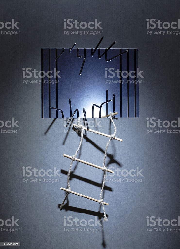 Close-up of broken prison window with ladders stock photo