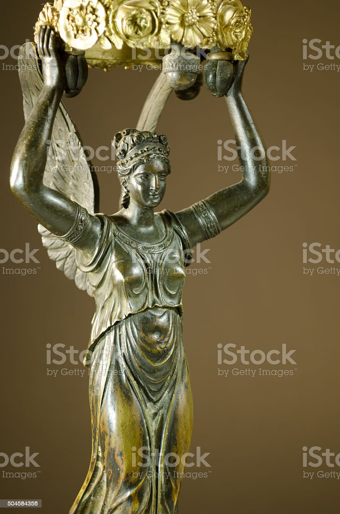 Close-up of Bronze Winged Victory Candelabra stock photo