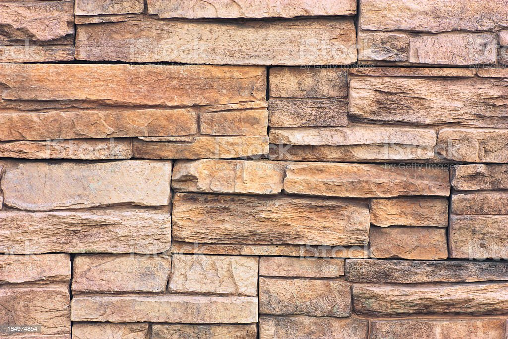 Closeup of brown and tan flagstone wall  stock photo