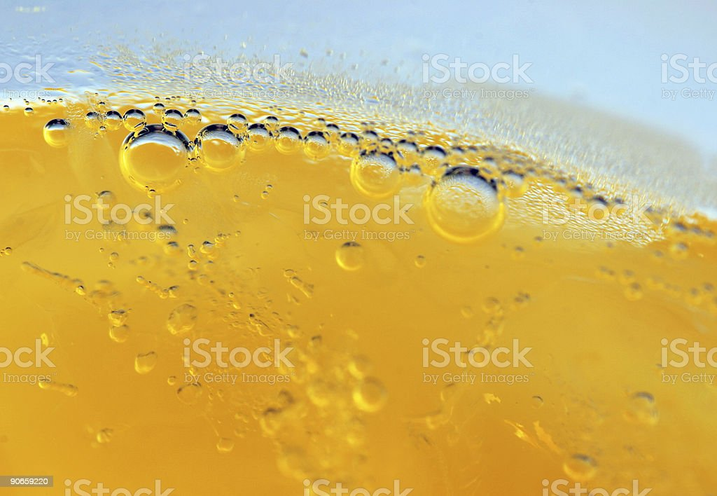 Close-up of bubbles in a yellow liquid stock photo
