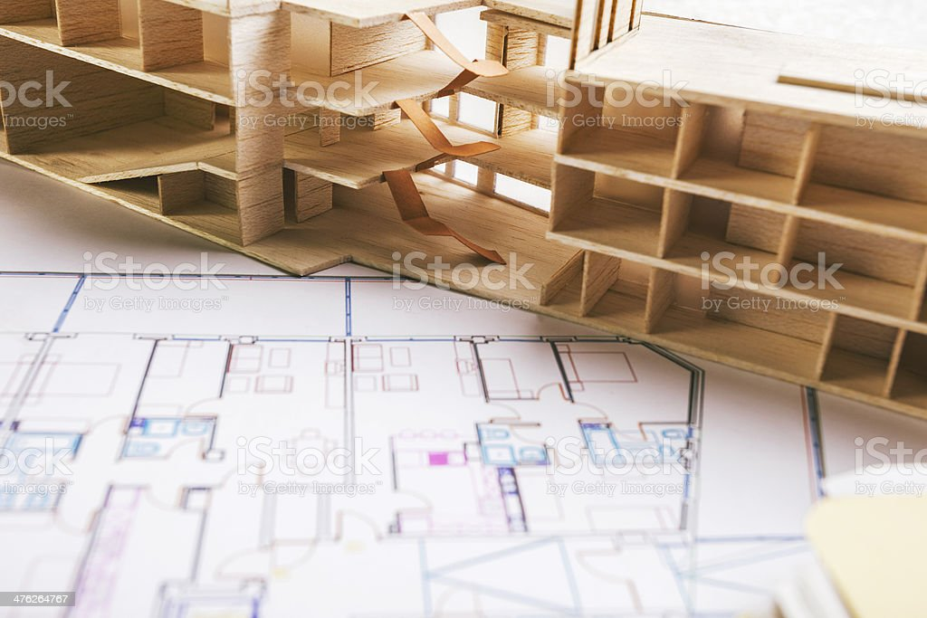 Closeup of building model and a construction plan. royalty-free stock photo