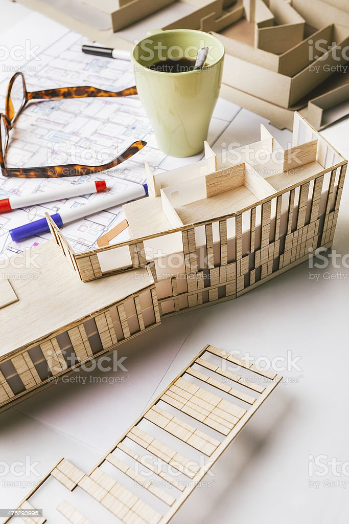 Closeup of building model and drafting tools on construction plan. royalty-free stock photo