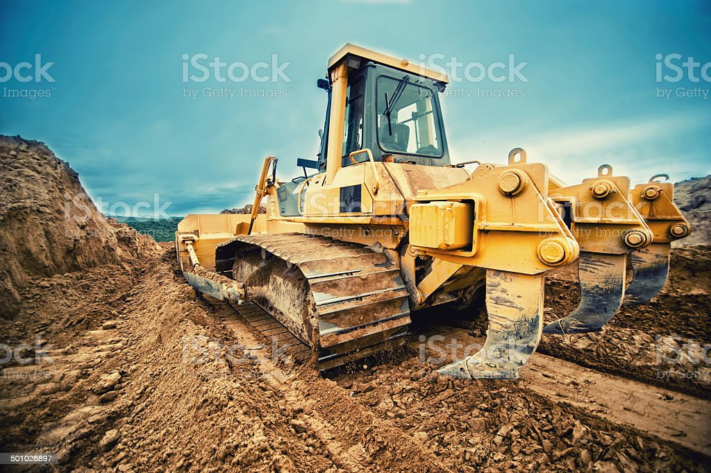 close-up of bulldozer or excavator working with soil on highway stock photo