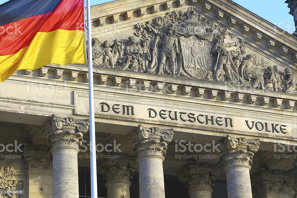Close-up of Bundestag with german flag, Berlin stock photo