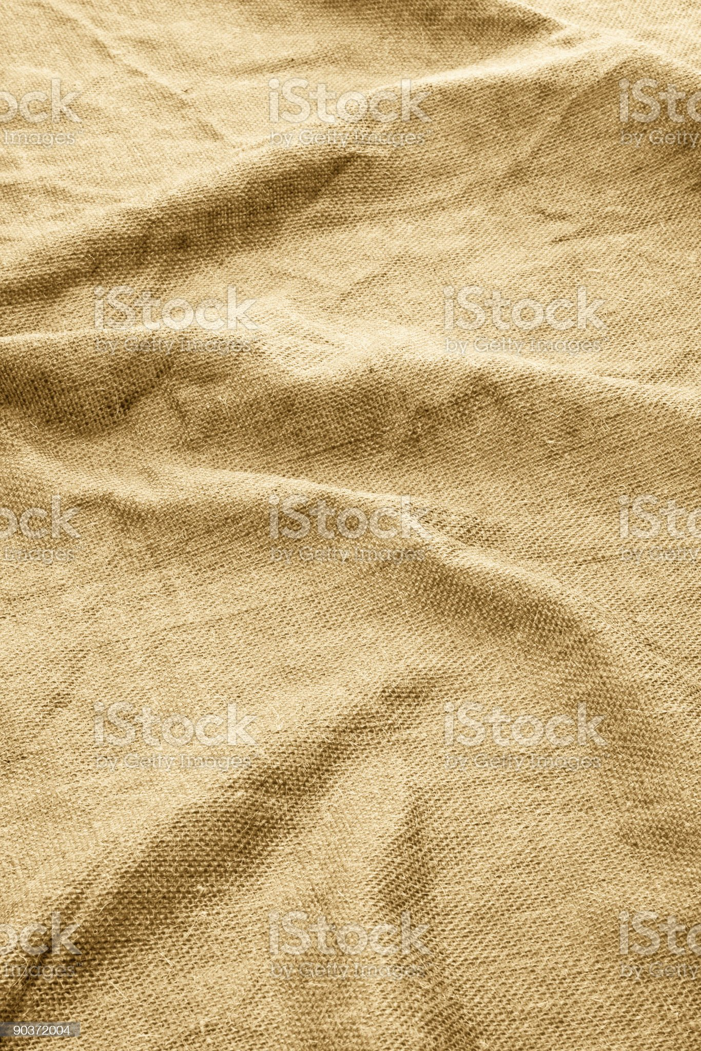 Closeup of Burlap Cloth Fabric With Ripples and Wrinkles royalty-free stock photo