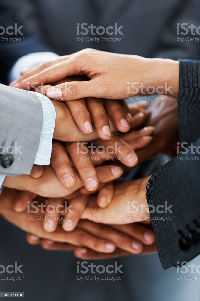 Close-up of business colleagues stacking hands in unity royalty-free stock photo