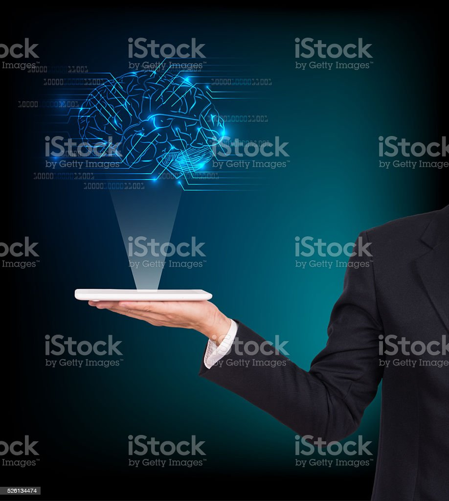 Close-up of business man brain with tablet in hand stock photo