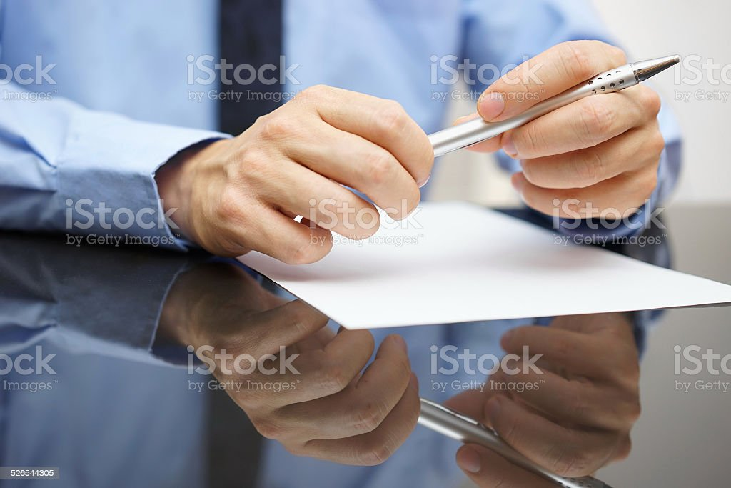 closeup of business man reading document or contract stock photo