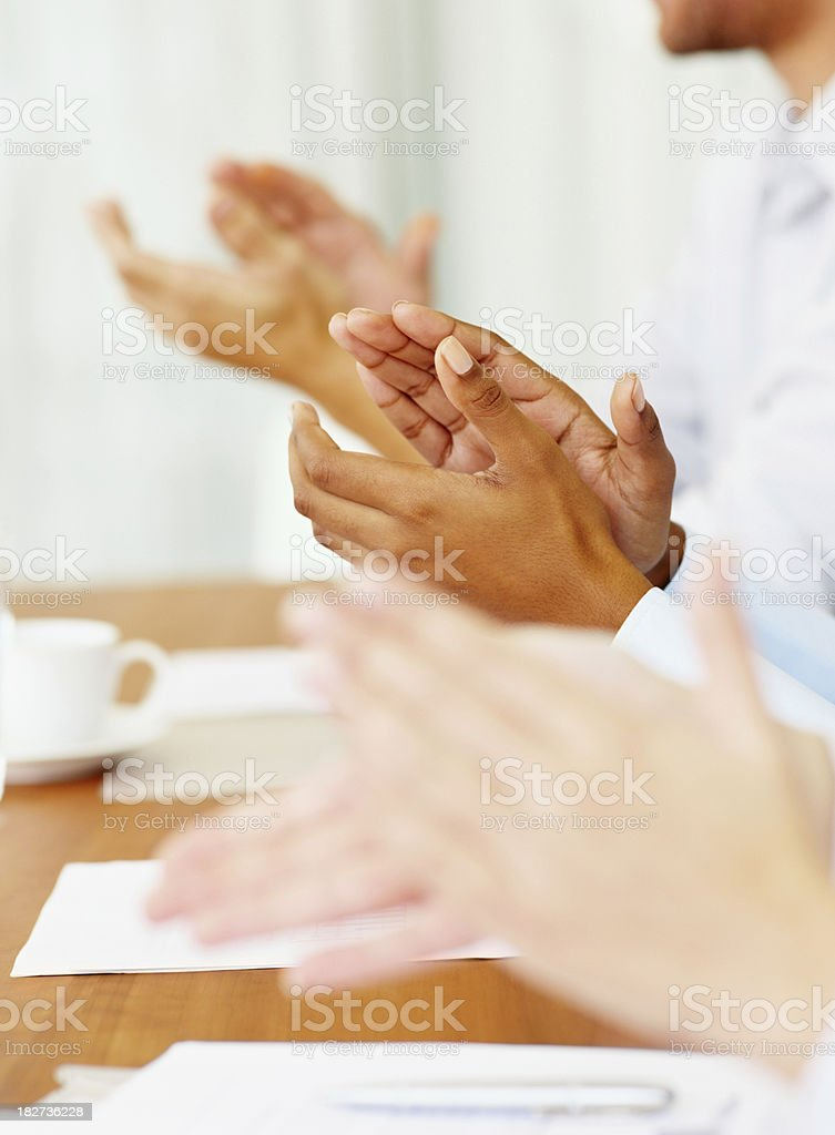 Closeup of business people clapping hands at a meeting royalty-free stock photo