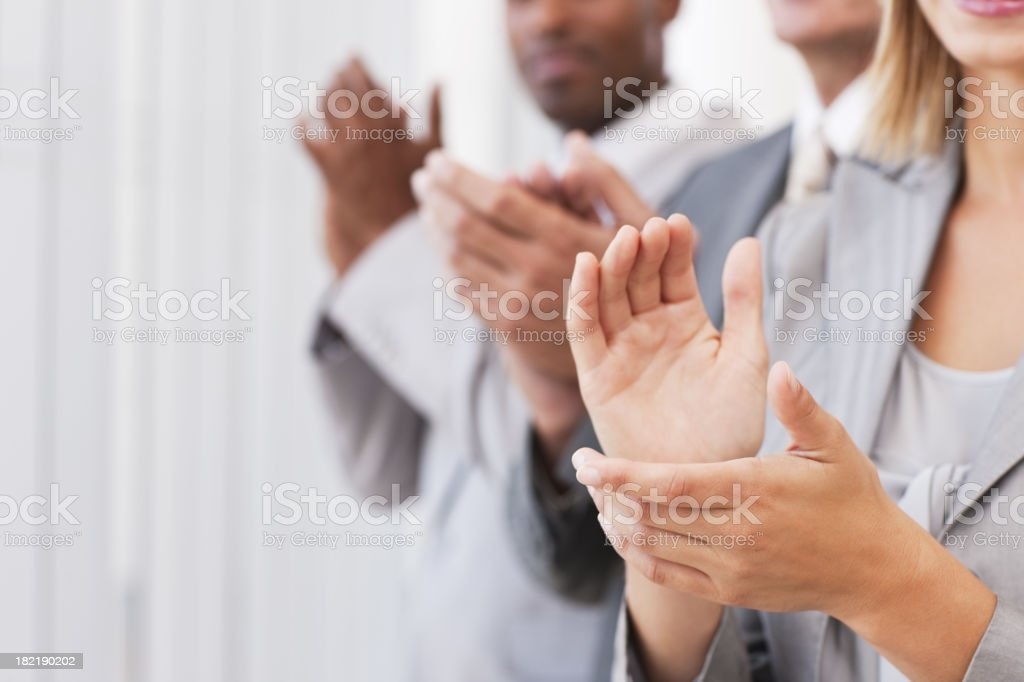 Closeup of business people clapping hands royalty-free stock photo