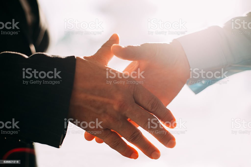 Close-up of business people hands shaking stock photo