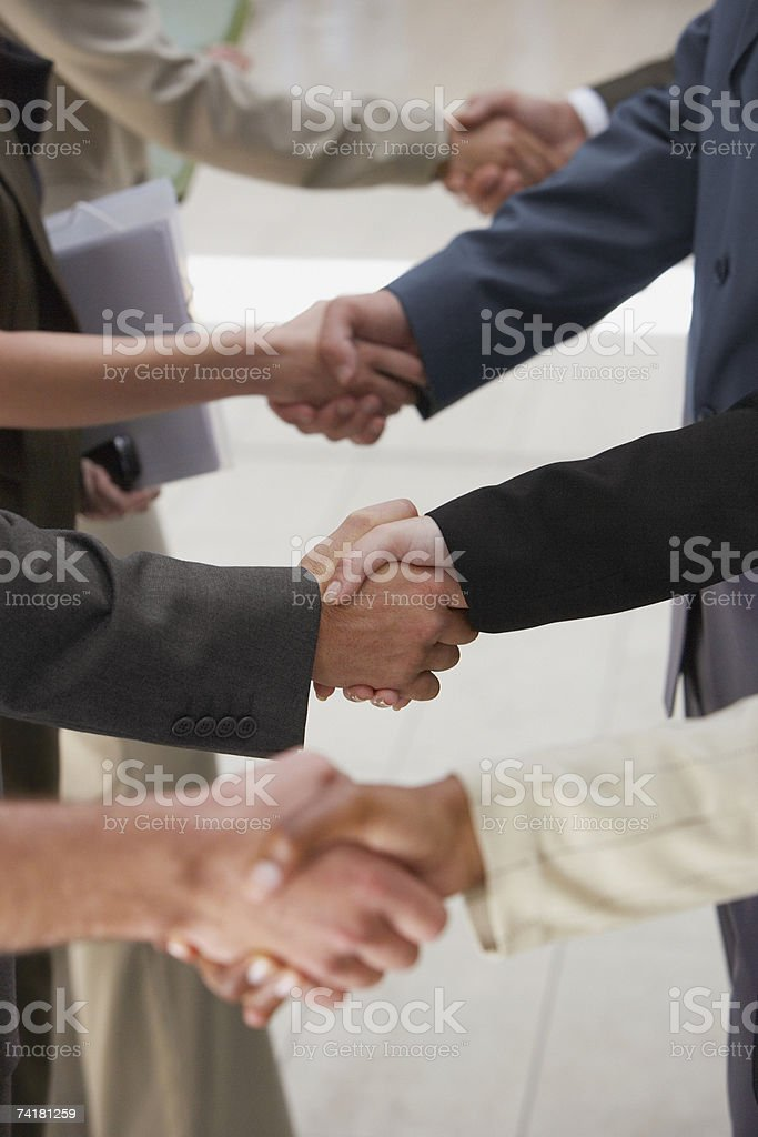 Close-up of business people shaking hands royalty-free stock photo