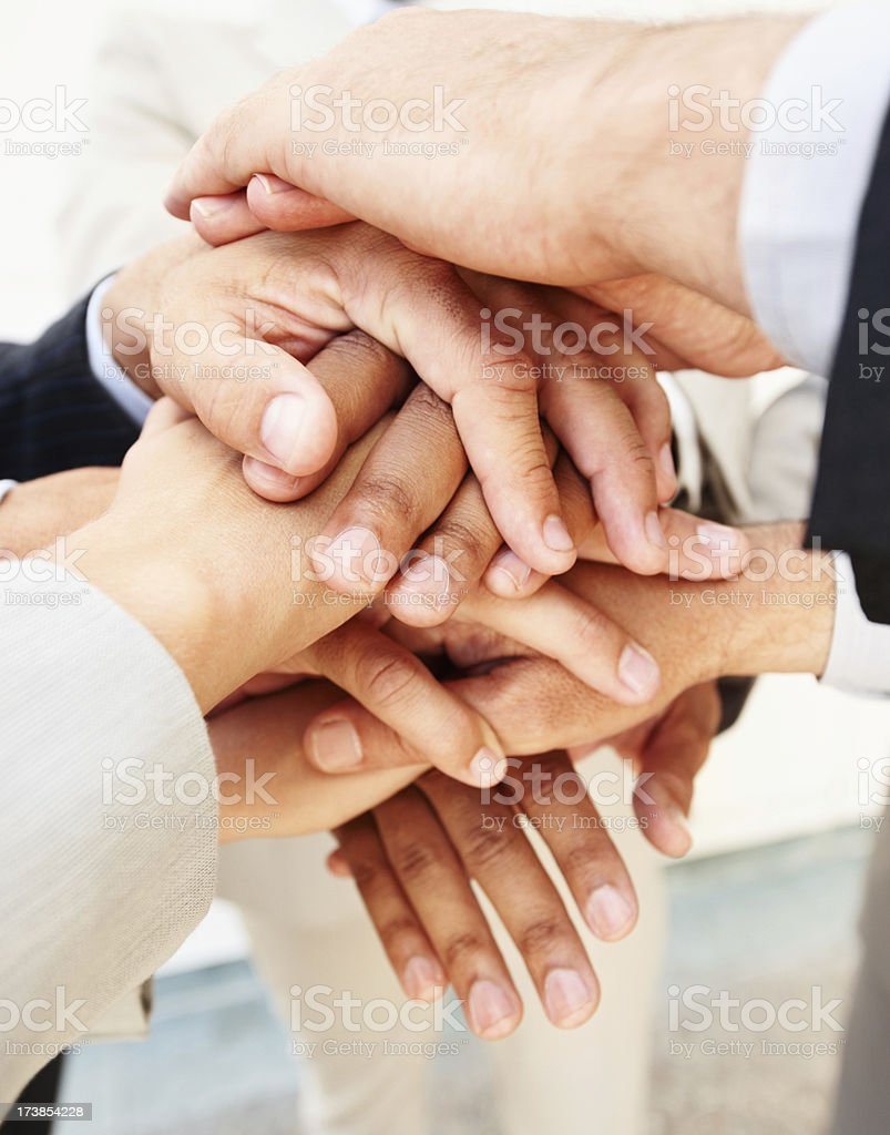 Close-up of business people with their hands together royalty-free stock photo