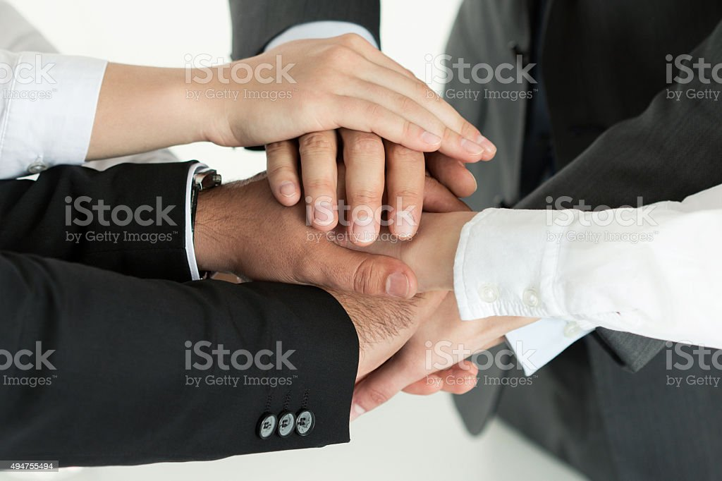 Closeup of business team showing unity stock photo