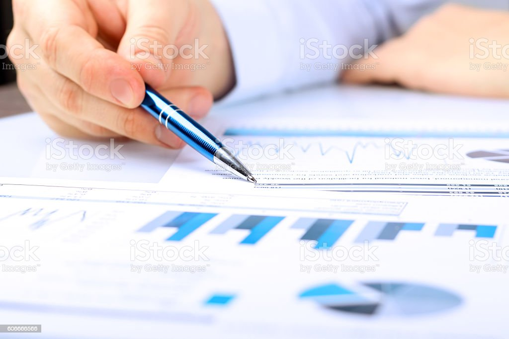 Close-up Of Businessman Analyzing Graph in the office stock photo