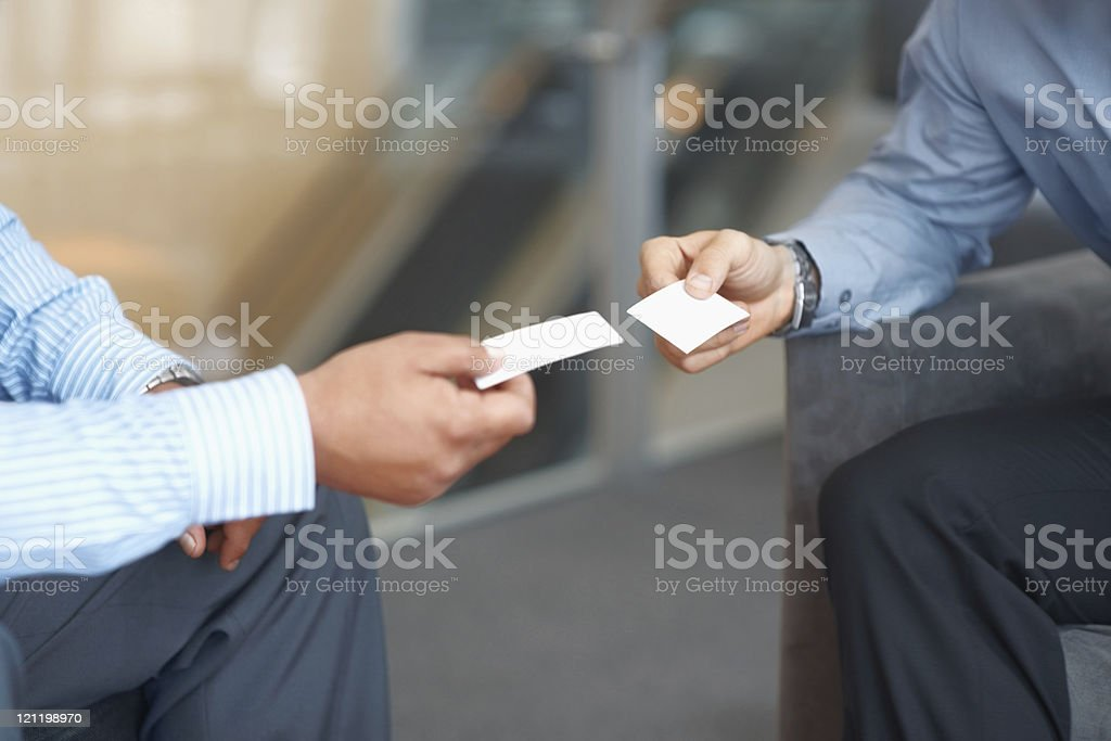 Closeup of businessman exchanging business card stock photo