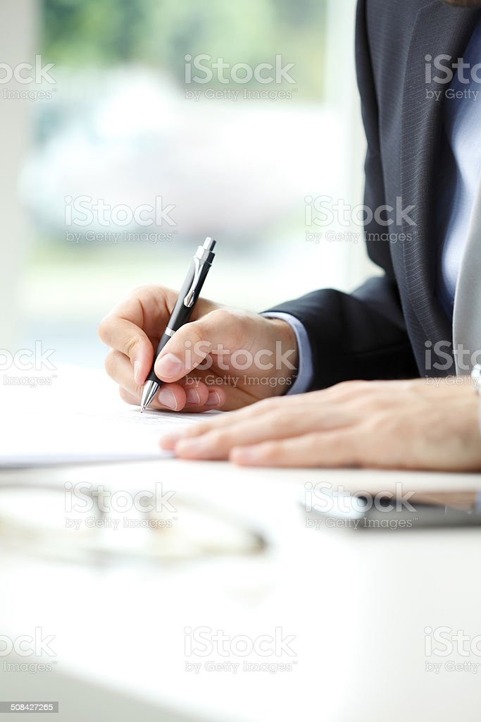Close-up of businessman fill the form stock photo