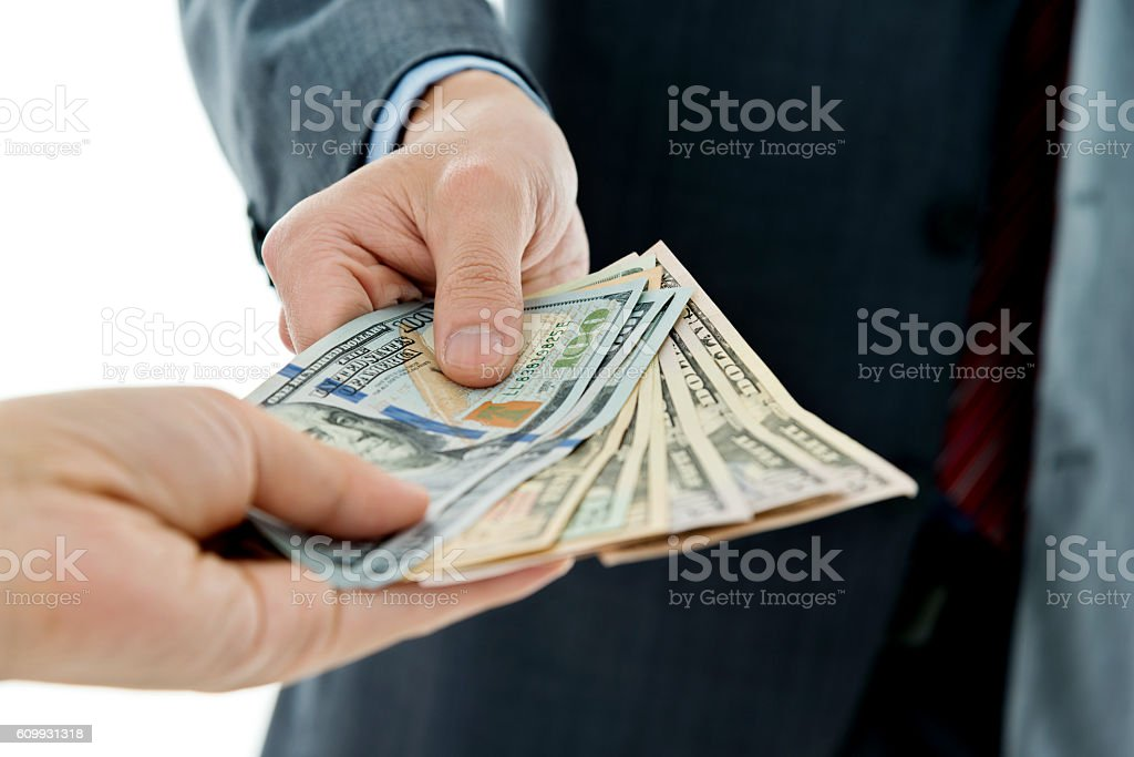 Closeup of businessman hands giving money stock photo