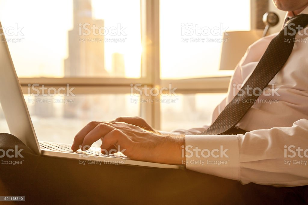 Close-up of businessman hands working on laptop stock photo