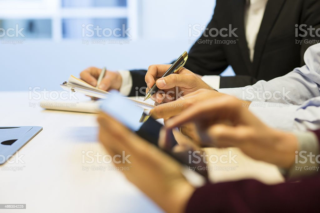 Close-up of Businessman hands working with document during a meeting royalty-free stock photo