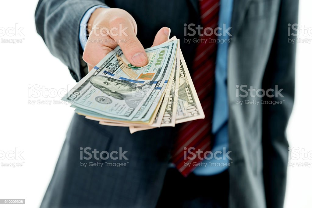 Closeup of businessman holding a stack of money stock photo
