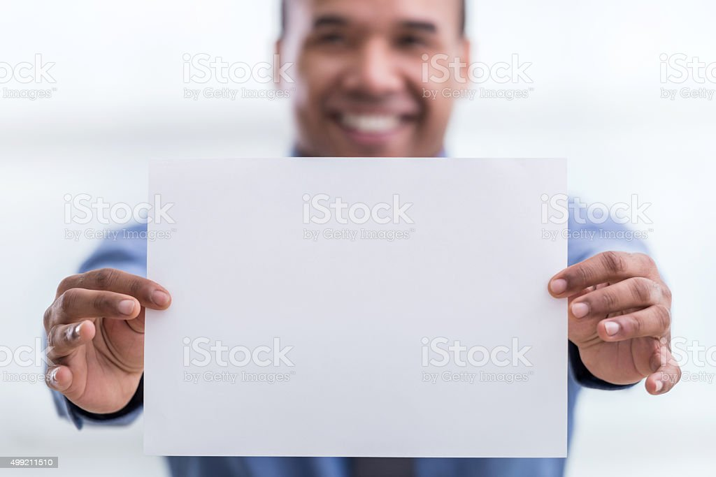 Close-up of businessman holding blank paper. stock photo