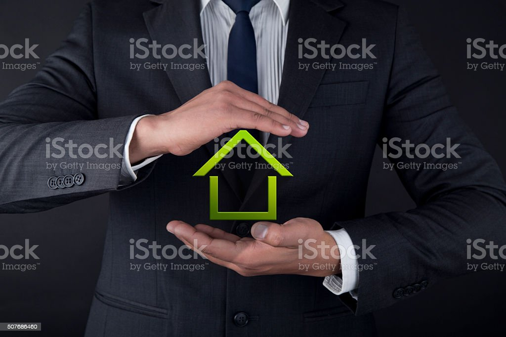 Close-up of businessman holding model home stock photo
