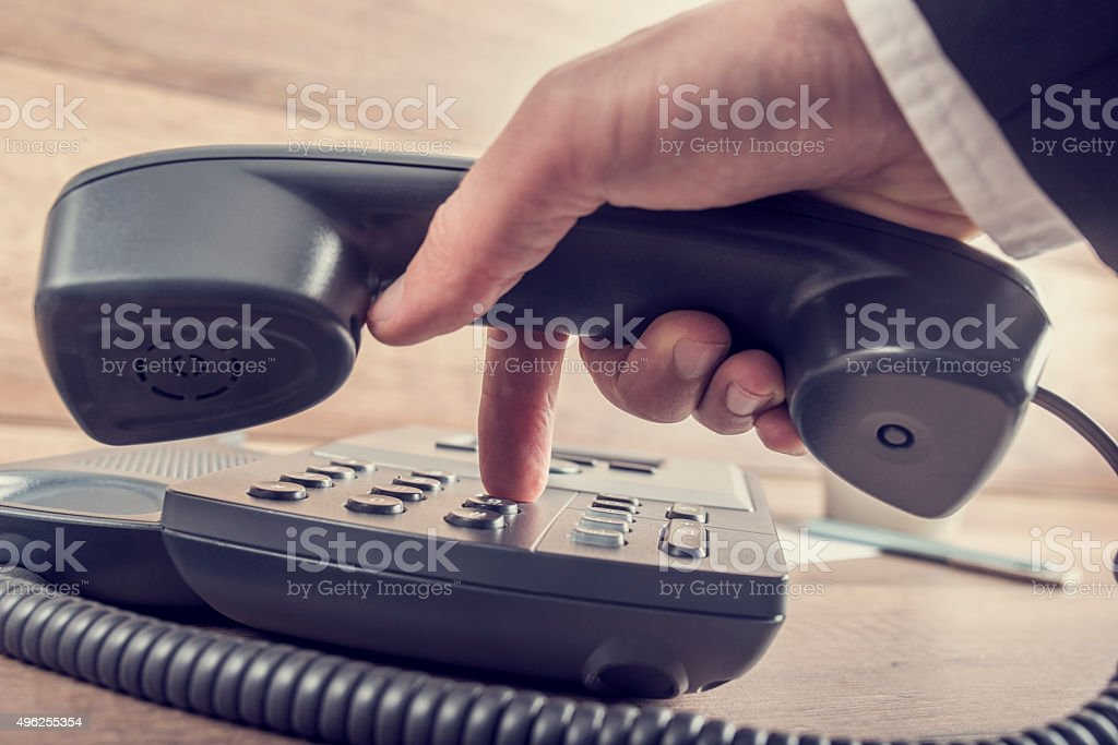 Closeup of businessman making a telephone call stock photo
