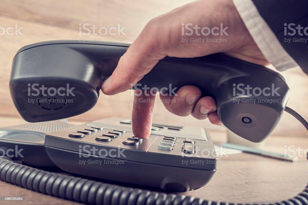 Closeup of businessman making a telephone call stock photo