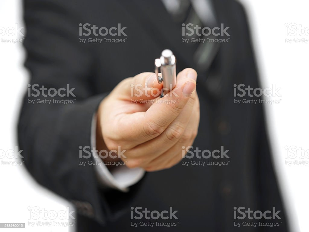 Closeup of businessman offering a pen stock photo