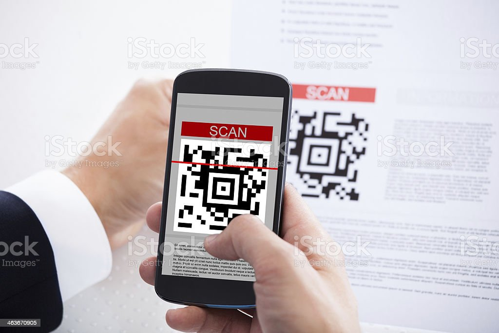 Close-up Of Businessman Scanning A Barcode stock photo