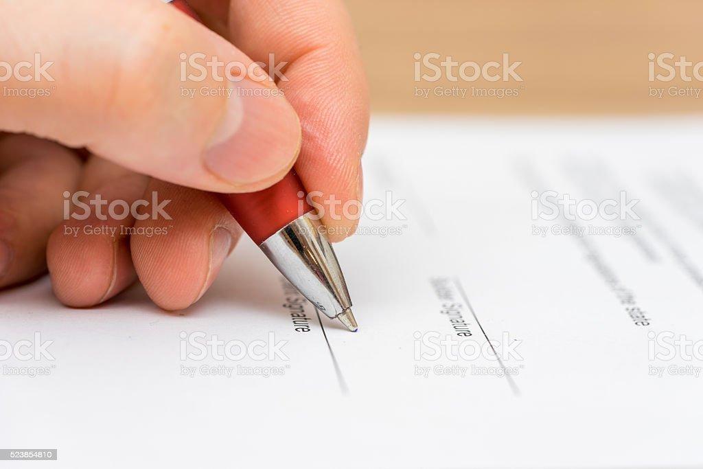 Closeup of businessman  signing contract stock photo