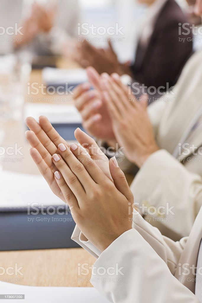 Closeup of businesspeople clapping royalty-free stock photo